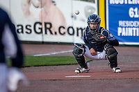 West Michigan Whitecaps catcher Dillon Dingler (10) warms up prior to the game against the Great Lakes Loons at LMCU Ballpark on May 11, 2021 in Comstock Park, Michigan. (Andrew Woolley/Four Seam Images)