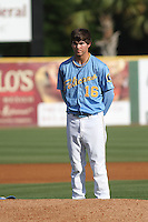 Myrtle Beach Pelicans pitcher Cody Buckel #16 standing for the national anthem before the first game of a doubleheader against the Carolina Mudcats at Tickerreturn.com Field at Pelicans Ballpark on May 10, 2012 in Myrtle Beach, South Carolina. Myrtle Beach defeated Carolina by the score of 2-1. (Robert Gurganus/Four Seam Images)
