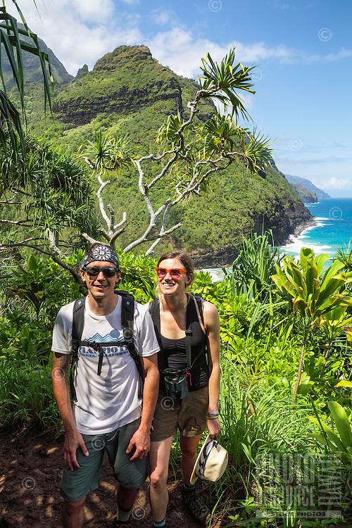 Two hikers on the Kalalau Trail near Hanakapi'ai Beach, Kaua'i.
