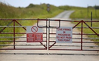 Thursday 15 June 2017<br />Pictured: A Keep Out Military Firing Range sign on the outer perimeter of Castlemartin range.<br />Re: A soldier has been killed and three others injured after an incident involving a tank at a Ministry of Defence base in Pembrokeshire.<br />The soldier, from the Royal Tank Regiment, died in the incident at Castlemartin Range.<br />Two people were taken to Morriston Hospital in Swansea, while another casualty remains in Cardiff's University Hospital of Wales.<br />An investigation is under way.<br />Live firing was scheduled to take place at the range between Monday and Friday.<br />In May 2012, Ranger Michael Maguire died during a live firing exercise at the training base. An inquest later found he was unlawfully killed.