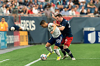 FOXBOROUGH, MA - AUGUST 18: Joseph Mora #28 of D.C. United attempts to control the ball as Tommy McNamara #26 of New England Revolution defends during a game between D.C. United and New England Revolution at Gillette Stadium on August 18, 2021 in Foxborough, Massachusetts.
