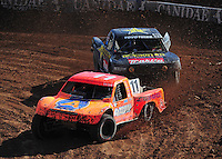 Dec. 10, 2011; Chandler, AZ, USA;  LOORRS pro 4 unlimited driver Adrian Cenni leads Kyle Leduc during round 15 at Firebird International Raceway. Mandatory Credit: Mark J. Rebilas-