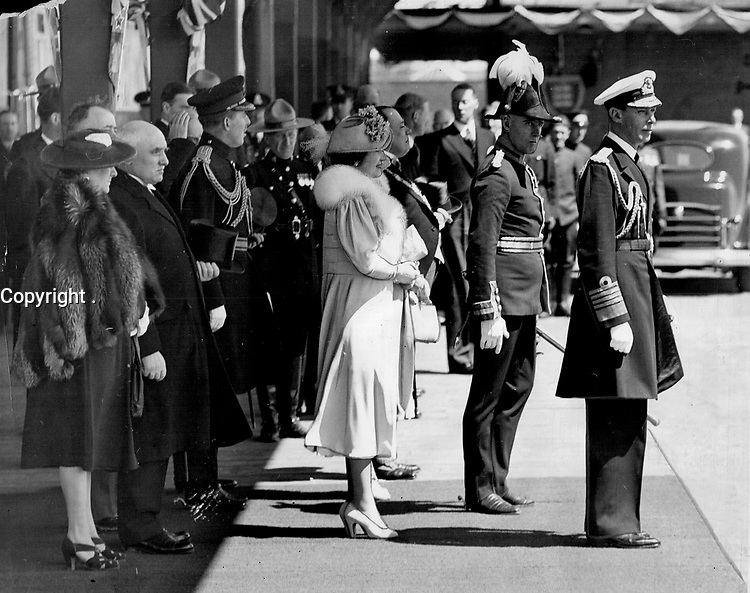 La visite du Roi George VI au Canada en 1939.<br /> <br /> <br /> <br /> <br /> <br /> La visite du Roi George VI au Canada en 1939.<br /> <br /> <br /> <br /> <br /> <br /> Since dawn vast throngs had waited in Montreal to see this scene; as the King and Queen stepped through the doorway of Park Avenue station. The previous night police had been forced to clear the station of people who came with blankets; prepared to spend the night. They came again in the early morning; still laden with blankets against the cold; including one old lady who sat by the door for eight hours to see the royal arrival.<br /> <br /> [unknown]<br /> Picture, 1939<br /> <br /> PHOTO : Toronto Star Archives - AQP