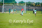 Ballyduff's Nathan McGrath fouls Padriag King of St Michaels Foilmore who is heading for goal in the County Senior football league.