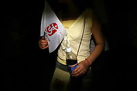 CHINA. Beijing. A woman holding an Olympic flag whilst watching the opening ceremony of the Beijing Summer Olympics. 2008
