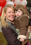 Whitley Levy and her daughter Margo,2, at the Lanier Law Firm's Holiday Bash Sunday Dec. 13,2009.(Dave Rossman/For the Chronicle)