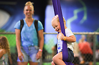 Hunter Wallace, 1, of Rogers swings, Friday, July 16, 2021 at Defy Rogers in Rogers. Kids played on trampolines, trapezes and in foam pits at the trampoline and extreme airsports park. Check out nwaonline.com/210717Daily/ for today's photo gallery. <br /> (NWA Democrat-Gazette/Charlie Kaijo)
