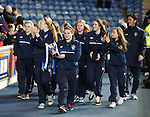 Rangers girls parade around the trackside at half-time