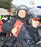 Photographer Tim de Waele and his driver wait for the race to restart in Cogoleto after heavy snow forces the race organizers to abandon part of the race over Passo del Turchino during the 104th edition of the Milan-San Remo cycle race, 17th March 2013 (Photo by Eoin Clarke 2013)
