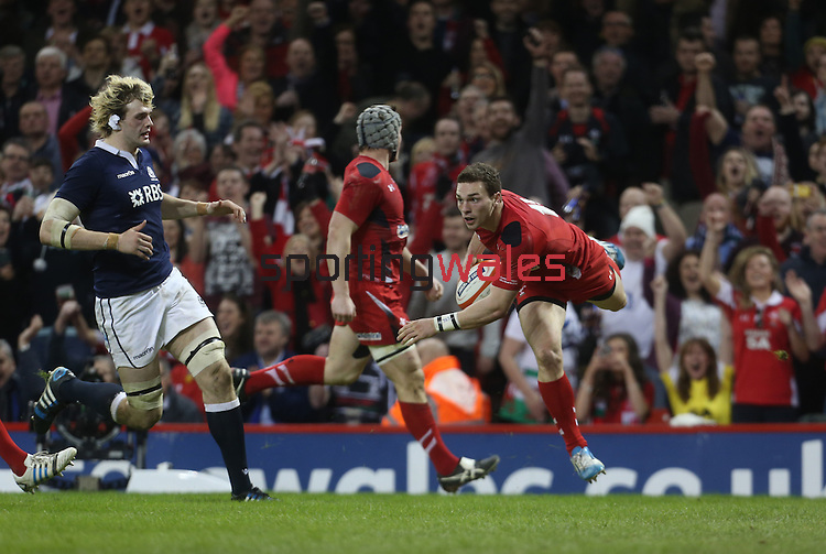 Wales wing George North dives over to score an early second half try.<br /> RBS 6 Nations 2014<br /> Wales v Scotland<br /> Millennium Stadium<br /> <br /> 15.03.14<br /> <br /> ©Steve Pope-SPORTINGWALES