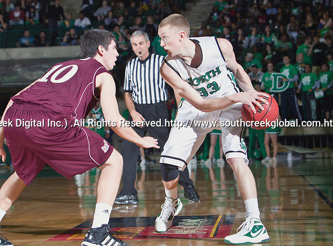 North Texas Mean Green guard Tyler Hall (33) and Louisiana Monroe Warhawks guard Trent Mackey (10) in action during the game between the Louisiana Monroe Warhawks and the University of North Texas Mean Green at the North Texas Coliseum,the Super Pit, in Denton, Texas. UNT defeats ULM 86 to 51...