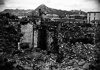 Scene of war damage in residential section of Seoul, Korea.  The capitol building can be seen in the background (right).  October 18, 1950.  Sfc. Cecil Riley. (Army)<br /> NARA FILE #:  111-SC-351356<br /> WAR & CONFLICT BOOK #:  1501
