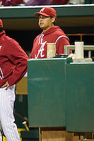 Alabama Crimson Tide coach Andy Phillips watches the action from the dugout during the game against the Auburn Tigers at Riverwalk Park on March 15, 2011 in Montgomery, Alabama.  Photo by Brian Westerholt / Four Seam Images