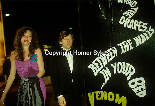 """Roman Polanski Cannes film festival May 1980. France. With Betsy Minetree Khashoggi  who was then,  an American 21 year old  blue jeans model called Betsy Farley. Not a film actress but was the  """"succes fou"""", of the festival raved Paris Martin, who went on to write  """"This year the US sent no strong films, as last year - but they sent us Betsy Farley.""""<br /> <br /> Girlfriend named thanks to Jon Mortas."""