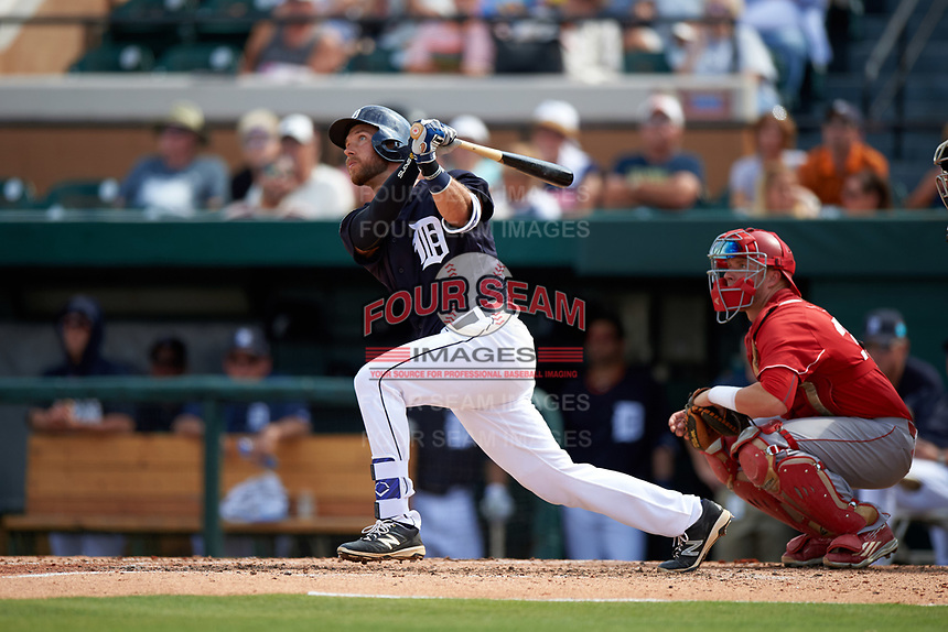Detroit Tigers catcher Austin Green (71) hits a home run in front of catcher Evan Barnes (39) during an exhibition game against the Florida Southern Moccasins on February 29, 2016 at Joker Marchant Stadium in Lakeland, Florida.  Detroit defeated Florida Southern 7-2.  (Mike Janes/Four Seam Images)