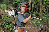 Mel Barnes, a logger for more than 30 years, heads off to work in the dense forest of Southwest Washington. He protects himself by wearing Kevlar chaps, a helmet, ear muffs and a mesh screen over his face.