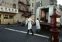 File Photo , New York , (NY) USA<br /><br /><br />Meat packers deliver pig meat to a restaurant in New York City's Chinatown<br /><br /><br />(c) by Pierre Roussel / IMAGES DISTRIBUTION