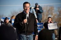 """Republican presidential candidate Mitt Romney, former governor of Massachusetts, speaks to supporters and the media during a rally in Manchester, New Hampshire, on Sat. Dec. 3, 2011. The rally was called, """"Earn It with Mitt,"""" and was designed to bolster local efforts to help Romney """"earn"""" voters' support for the upcoming Republican primary."""