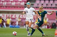 KASHIMA, JAPAN - JULY 27: Julie Ertz #8 of the United States dribbles with the ball during a game between Australia and USWNT at Ibaraki Kashima Stadium on July 27, 2021 in Kashima, Japan.