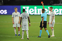 WASHINGTON, DC - AUGUST 25: Scott Caldwell #6 of New England Revolution gets a red card from referee Guido Gonzales Jr during a game between New England Revolution and D.C. United at Audi Field on August 25, 2020 in Washington, DC.