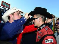 Sept. 23, 2012; Ennis, TX, USA: NHRA funny car driver Bob Tasca III is fitted for a cowboy hat after winning the Fall Nationals at the Texas Motorplex. Mandatory Credit: Mark J. Rebilas-