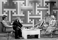 Montreal (Qc) CANADA - May 25 1984. RAJ (Rassemblement Autonome des Jeunes) representative (L) discuss with Pauline Marois (R) at at TV debate hosted by Mathias Rioux and Jean Cournoyer