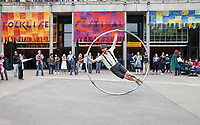 Cyr Wheel Street Performer, Northwest Folklife Festival 2016, Seattle Center, Washington, USA.