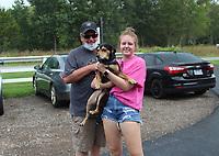 Dennis Brumley, daughter Dalynn Brumley and Ollie enjoy the Humane Society benefit.<br /> (NWA Democrat-Gazette/Carin Schoppmeyer)