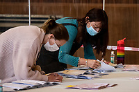 Pictured: Two ladies count the ballot papers during the Swansea West and South West Wales Regional Election Count at Brangwyn Hall in Swansea, Wales, UK. Friday 07 May 2020