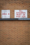 "Motherwell 3 Dundee 1, 12/12/2015. Fir Park, Scottish Premiership. A sign reading ""All children must be paid for"" on the wall of a stand at Fir Park, home to Motherwell Football Club, before they played Dundee in a Scottish Premiership fixture. Formed in 1886, the  home side has played at Fir Park since 1895. Motherwell won the match by three goals to one, watched by a crowd of 3512 spectators. Photo by Colin McPherson."