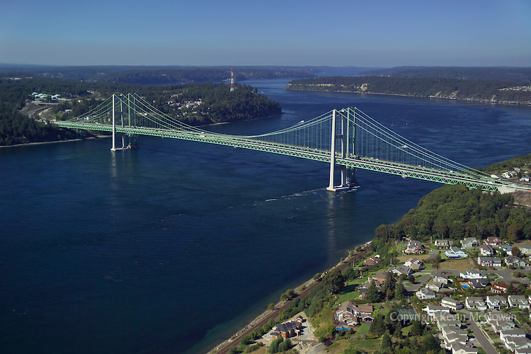 Aerial view of new and old Tacoma Narrows Bridge spanning the Tacoma Narrows strait. Vashon Island and Colvos Passage in distance