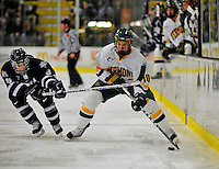 1 February 2008: University of Vermont Catamounts' forward Colin Vock, a Sophomore from Plymouth, MI, is checked by University of New Hampshire Wildcats' forward Greg Collins, a Junior from Fairport, NY, at Gutterson Fieldhouse in Burlington, Vermont. The seventh-ranked Wildcats defeated the Catamounts 5-1in front of a sellout crowd of 4,003...Mandatory Photo Credit: Ed Wolfstein Photo