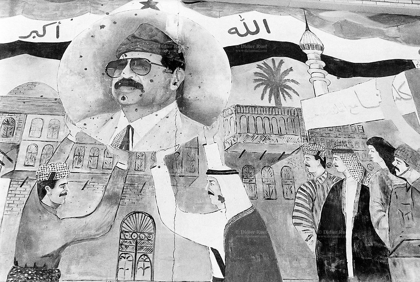 Iraq. Baghdad. Abu Ghraib prison. A drawing on the wall celebrates Saddam Hussein's regime and the union in the country between the Sunni, Shiite and kurd people. Iraqi flag and minaret. © 2003 Didier Ruef