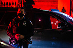 BROOKLYN, NY — SEPTEMBER 25, 2020:  An NYPD officer stands in front of bullet holes in the window of a Jeep Cherokee at the scene of a double shooting, where one man was killed and another seriously injured, on the corner of Marcus Garvey Blvd and Monroe Street early in the morning on September 26, 2020 in the Brooklyn borough of New York City.  Photograph by Michael Nagle