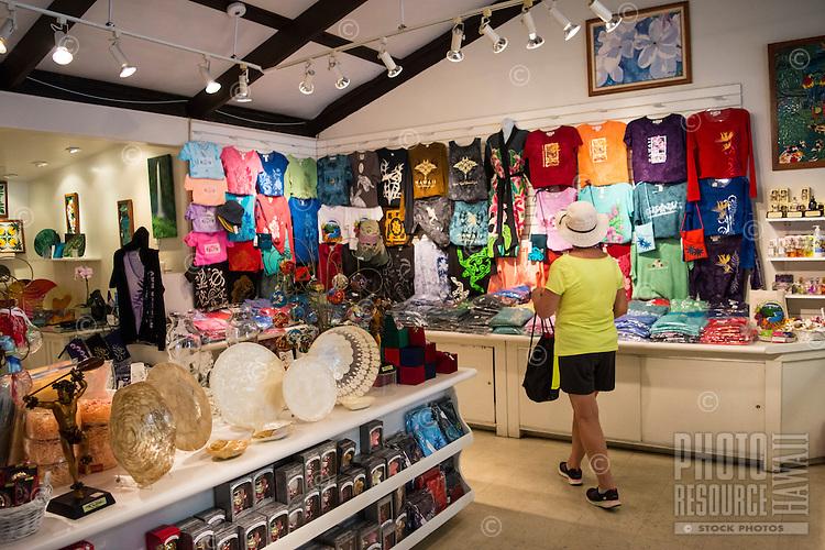 A woman strolls through the gift shop at Hawaii Tropical Botanical Garden in Papa'ikou near Hilo, Big Island of Hawai'i.