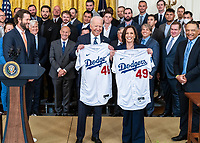 President Joe Biden and Vice President Kamala Harris pose for a photo with their baseball jerseys during a celebration for the 2020 Baseball World Series Champions, the Los Angeles Dodgers, Friday, July 2, 2021, in the East Room of the White House. (Official White House Photo by Adam Schultz)