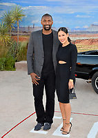 """LOS ANGELES, USA. October 08, 2019: Ron Artest & Maya Ford at the premiere of """"El Camino: A Breaking Bad Movie"""" at the Regency Village Theatre.<br /> Picture: Paul Smith/Featureflash"""