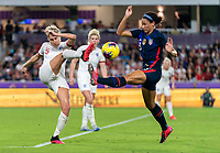 ORLANDO, FL - MARCH 05: Steph Houghton #5 of England clears the ball into Lynn Williams #13 of the United States during a game between England and USWNT at Exploria Stadium on March 05, 2020 in Orlando, Florida.