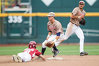 Virginia Cavaliers second baseman Ernie Clement (4) waits for the throw from the catcher against the Arkansas Razorbacks in Game 1 of the NCAA College World Series on June 13, 2015 at TD Ameritrade Park in Omaha, Nebraska. Virginia defeated Arkansas 5-3. (Andrew Woolley/Four Seam Images)