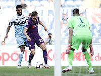 Football, Serie A: S.S. Lazio - Fiorentina, Olympic stadium, Rome, 7 ottobre 2018. <br /> Lazio's Fortuna Wallace (l) in action with Fiorentina's Federico Chiesa (c) in front of Lazio's goalkeeper Thomas Strakosha (r) during the Italian Serie A football match between S.S. Lazio and Fiorentina at Rome's Olympic stadium, Rome on October 7, 2018.<br /> UPDATE IMAGES PRESS/Isabella Bonotto