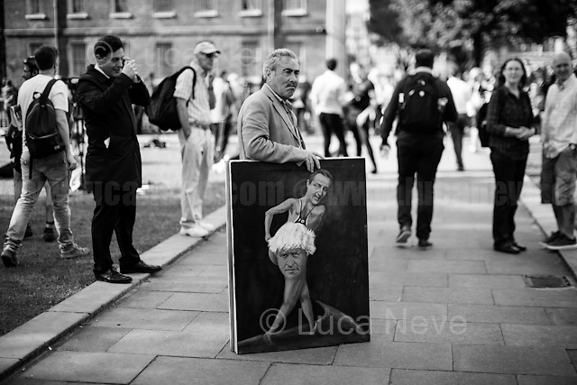 """Kaya Mar (Painter and political caricaturist - For more information about the Artist please click here: http://www.kayamarart.com/ ).<br /> <br /> 24.06.2016 - """"Faces From College Green (Part 2), Parliament Sq, WhiteHall"""".<br /> <br /> London, March-July 2016. Reporting the EU Referendum 2016 (Campaign, result and outcomes) observed through the eyes (and the lenses) of an Italian freelance photojournalist (UK and IFJ Press Cards holder) based in the British Capital with no """"press accreditation"""" and no timetable of the main political parties' events in support of the RemaIN Campaign or the Leave the EU Campaign.<br /> On the 23rd of June 2016 the British people voted in the EU Referendum... (Please find the caption on PDF at the beginning of the Reportage).<br /> <br /> For more photos and information about this event please click here: http://lucaneve.photoshelter.com/gallery/Faces-From-College-Green-Part-2-Parliament-Sq-WhiteHall/G0000EdpxLbG0I3k/C0000LiS.GOfEuNk<br /> <br /> For more information about the result please click here: http://www.bbc.co.uk/news/politics/eu_referendum/results"""