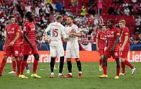 14th September 2021; Sevilla, Spain: UEFA Champions League football,  Sevilla FC versus RB Salzburg;  Rakitic and En-Nesyri discuss the penalty taker