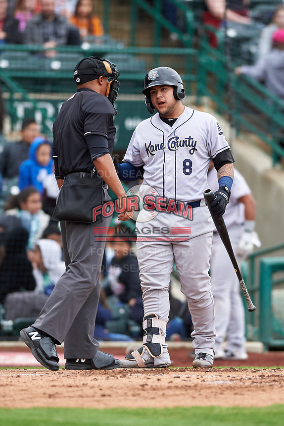 Kane County Cougars Jose Herrera (8) talks to home plate umpire Thomas Burrell after at bat during a Midwest League game against the Fort Wayne TinCaps at Parkview Field on May 1, 2019 in Fort Wayne, Indiana. Fort Wayne defeated Kane County 10-4. (Zachary Lucy/Four Seam Images)