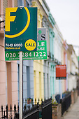 For sale signs in a Victorian terraced street in Camden Town, London
