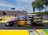 Jun. 1, 2014; Englishtown, NJ, USA; NHRA funny car driver Jack Beckman (near lane) races alongside Matt Hagan during the Summernationals at Raceway Park. Mandatory Credit: Mark J. Rebilas-