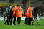 Rhodri Gomer-Davies is carried off injured. Swansea Neath Ospreys Vs Newport Gwent Dragons, Magners league, Liberty Stadium © IJC Photography. Photographer Ian Cook