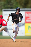 Cody Daily (31) of the Kannapolis Intimidators hustles towards third base against the Lakewood BlueClaws at Kannapolis Intimidators Stadium on May 8, 2016 in Kannapolis, North Carolina.  The Intimidators defeated the BlueClaws 3-2.  (Brian Westerholt/Four Seam Images)