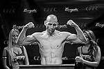 Visibly gaunt and finally down to 170 pounds, George Sullivan of Brick flexes as he weighs in for his welterweight MMA title defense against Philadelphia native Jesus Martinez in Atlantic City in August.
