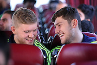 Wednesday 26 February 2014<br /> Pictured L-R: David Cornell and Ben Davies sharing a joke on the coach en route to Cardiff Airport.<br /> Re: Swansea City FC travel to Italy for their UEFA Europa League game against Napoli.