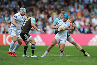 Jack Nowell of Exeter Chiefs is tackled by George Merrick of Harlequins during the Aviva Premiership match between Harlequins and Exeter Chiefs at The Twickenham Stoop on Saturday 7th May 2016 (Photo: Rob Munro/Stewart Communications)